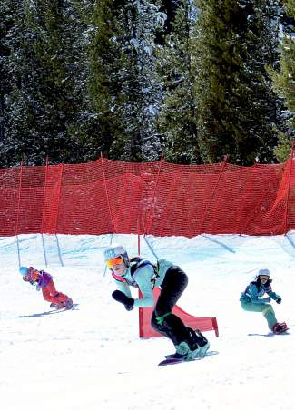 A group of three in the youth girl's division (14-15 years old) head into the final few turns during a boardercross qualifier at the USASA National Championships at Copper on April 6.