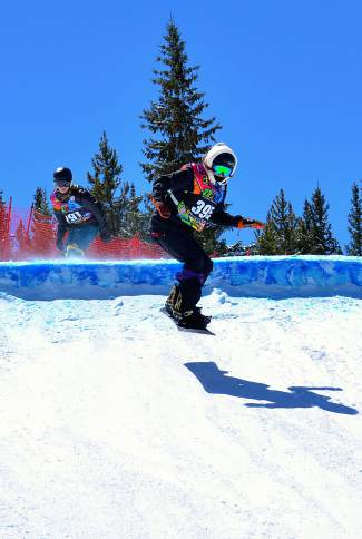 Two racers in the youth girl's division (14-15 years old) pass over a snow feature halfway through the boardercross course during a qualifier at the USASA National Championships in Copper on April 6.