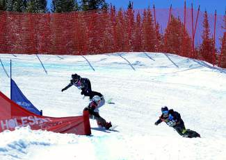 A trio of athletes rounds through a berm and into a snow feature on the boardercross course during a qualifying round of the USASA National Championships at Copper Mountain on April 6.