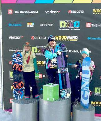 Team Summit's Alysa Moroco (right) on the podium after taking third for halfpipe in the Grommet girl's division at the USASA National Championships in Copper.