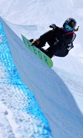 Kaitlyn Adams of Springfield, Ohio eyes her next line in the halfpipe at the women's open division qualifier at the USASA National Championships in Copper on April 7.