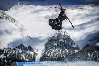 A skier airs of a slopestlye feature at Copper Mountain Resort during the 2014 Revolution Tour. The annual tour is considered a stepping stone for amateur athletes and aspiring pros, with Rev Tour qualifiers beginning as early as Dec. 2 at Copper before the tour halfpipe competition Dec. 6-11.