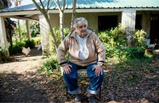 "Uruguay's President Jose Mujica sits outside his home during an interview on the outskirts of Montevideo, Uruguay, Friday, May 2, 2014. Mujica said Friday that his country's legal marijuana market will be much better than Colorado's, where he says the rules are based on ""fiction"" and ""hypocrisy"" because the state loses track of the drug once it's sold and many people fake illnesses to get prescription weed. Mujica says this won't be allowed in Uruguay, where the licensed and regulated market will be much less permissive with drug users. (AP Photo/Matilde Campodonico)"