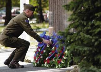 Scott Koskie lays a wreath against the 10th Mountain Division Memorial during the 46th annual Memorial Day ceremony at the summit of Tennessee Pass. This year marks the 55th anniversary of the annual ceremony, which begins promptly at 11 a.m. Monday.