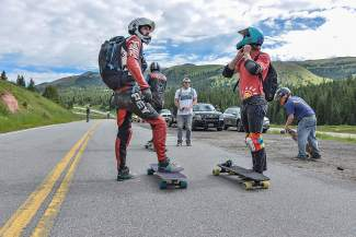 Ohio natives Russ Janoviak (left) and his brother, Jake, prepare for the first longboard run down Vail Pass. Downhill longboarders often wear motorcycle leathers to protect against the inevitable road rash.