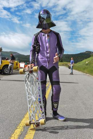 Like Darth Vader on wheels: The typical outfit for a downhill longboarder, with just a touch of sci-fi flair.