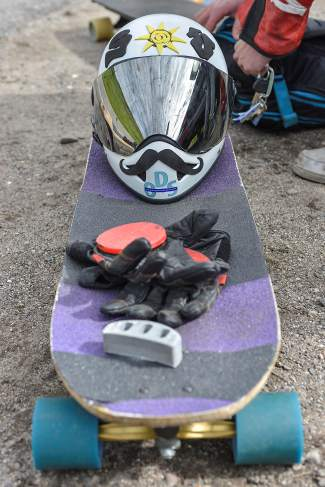 The gear: A mustachioed helmet, sliding gloves and custom longboard, complete with a nose-mounted attachment to prevent slipping in corners.