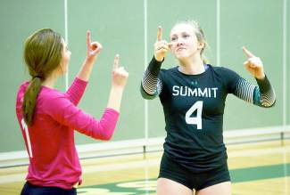 Summit's Lexi Zangari (4) and Sage Kent (1) dance to the tune of Ottis Redding's