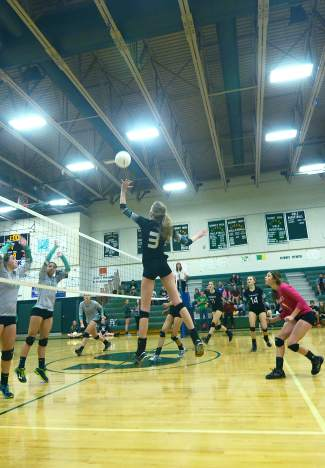 Summit's Emily Wallace (3) goes for a kill against No. 5 Delta during a varsity volleyball game at home on Oct. 12. The Tigers lost 1-3.
