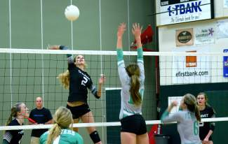 Summit's Anna Dodson (2) goes for a kill at the Tigers' home game against No. 5 Delta this week, shot by @sumcosports
