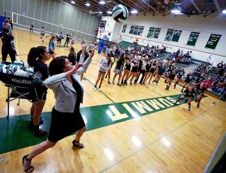 Summit High School volleyball coach Liz Waddick warms up her team before their homecoming match against Steamboat Springs on Oct. 1. The Tigers would go on to lose 1-3.