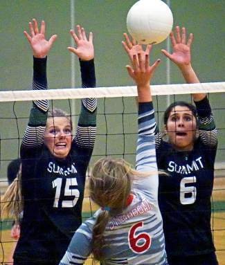 Summit's Autumn Ward (15) and Michelle Frias (6) attempt to block a spike by Steamboat Springs hitter Micah Feeley during the Tigers' 1-3 homecoming loss on Oct. 1. The Tigers are now at 2-4 in the 4A Western Slope.