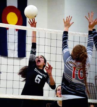 Summit's Michelle Frias (6) tips the ball over Steamboat Springs defender Hayley Johnson during the Tiger's 1-3 loss homecoming loss on Oct. 1.