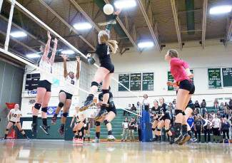 Tigers hitter Lexi Zangari (4) gets a hard spike on Eagle Valley at home, shot by @louietraub