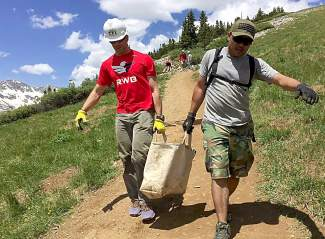 VFW Post 1 members Brandon Young (left) and Murphy Phandone team up to carry rocks down the trail at Quandary Peak during a volunteer work day on June 25. The Denver-based VFW post is the oldest in the nation and regularly works with local organizations like the Colorado Fourteeners Initiative for volunteer projects.