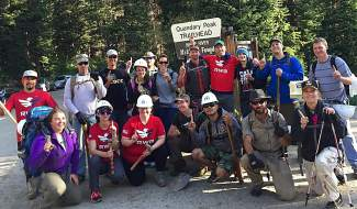 A group of volunteers with VFW Post 1 of Denver and Team Red, White and Blue pose for a photo before tackling the first stetch of trail at Quandary Peak for a work day on June 25. The two groups moved rocks for a retaining wall in the final stretch of wooded trail before reaching the first step.