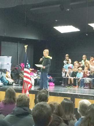 Several children read poems honoring those who had served, including Breckenridge Elementary student  Cole Stuckey.