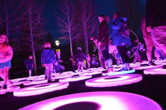 The Pool, by Jen Lewin out of Boulder, Colorado, is a playground of platforms that respond to human interaction, creating giant pools of light as people touch, walk and jump on them.