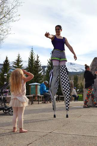 Stilt dancers from Frequent Flyers got high-fives from kids at the Blue River Plaza.