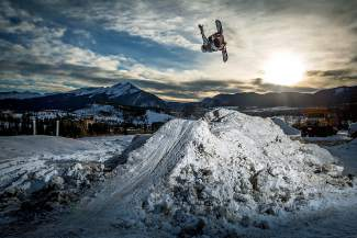Red Gerard gets inverted on the kicker in his backyard on Ptarmigan Ridge high above Silverthorne. Dozens of Summit County residents with private property build rails and other small snow features for private use.