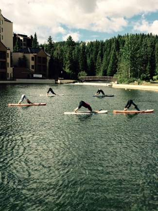 Walking on water: Yogis flow through poses on Maggie Pond during SUP yoga, offered 2-3 times per week by Blue Lotus Yoga in Breckenridge.