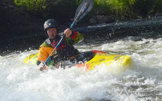 Matti Wade of Ten Mile Creek Kayaks paddles a Pyranha Fusion through the Frisco kayak park in 2015.