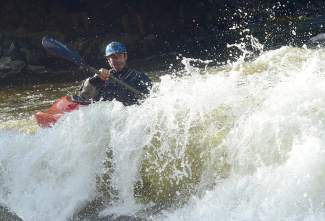 Justin Thiede eyes his next line at the Frisco kayak park on Ten Mile Creek.
