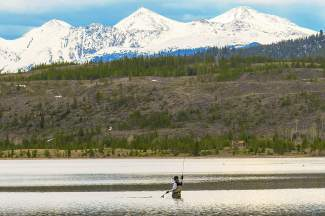 An angler fishes near the Tenmile Creek inlet on Dillon Reservoir in spring 2015. Fly-fishing seems like a relatively low-impact sport, but early in the season, local anglers suggest simple exercises to re-condition arm and wrist muscles that tend to get ignored all winter.