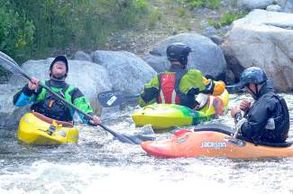 Darrell Haggard (left) waits his turn with Matti Wade (center) and Justin Thiede at the Frisco kayak park on Ten Mile Creek.