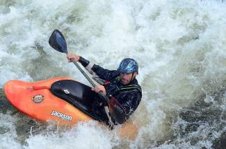 Justin Thiede deep in the whitewater at the Frisco kayak park on Ten Mile Creek.