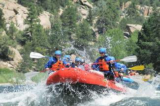 Rafters get a whitewater shower last season in Browns Canyon, one of the first stretches of Colorado river to open every May. Performance Tours Rafting in Breckenridge and several outfitters started taking tours to the area on May 1.