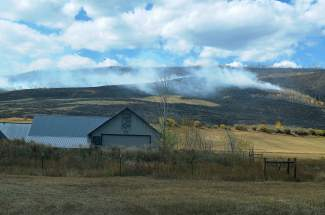 Wildfire near Brush Creek Ranch keeps fire crews busy on Saturday as they attempt to contain the blaze.