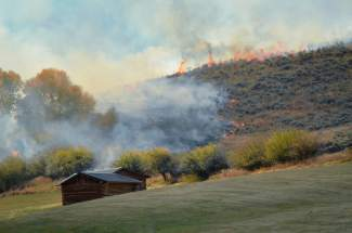 The hillside behind Brush Creek Ranch burned as crews worked to contain the fire. The U.S. Forest Service determined the cause of the fire to be a lightning strike on Thursday, after the fire was fully contained Sunday evening.