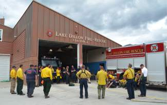 Crews from Summit County's three fire departments — Lake Dillon Fire-Rescue, Copper Mountain Fire and the Red, White & Blue Fire Protection District — meet and chat at LDFR's Station 2 in Frisco on Thursday, June 30, following a wildfire training exercise in nearby Bill's Ranch.