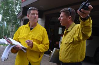 Red, White & Blue battalion chief Skip Bergbauer (left) and Lake Dillon Fire-Rescue captain John Wilkerson worked together as joint leaders on the wildland-urban interface fire drill on Tuesday, June 30, helping to assess the situation at Bill's Ranch and deploying their crews and resources as needed.