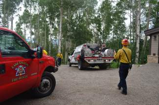 Wildland-urban interface crews arrive to the scene of an imaginary fire at a home in Bill's Ranch near Frisco on Tuesday, June 30.