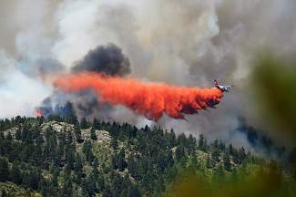A slurry bomber make a drop along a ridge near highway 119 in Nederland fighting the Cold Springs Fire July 10, 2016.