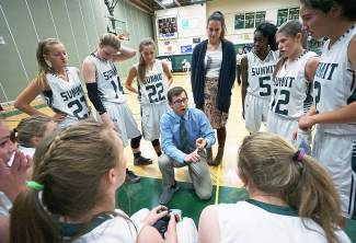 Summit High School girl's varsity basketball coach Colton St. Peter talks to his team during a timeout at a home game against Eagle Valley in January. The team is sitting right below the .500 mark halfway through the season with the majority of league play still to come.