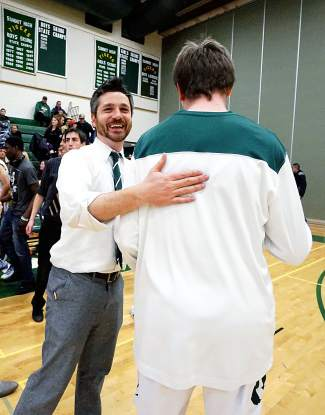 Summit High School boy's varsity basketball coach Paul Koslovsky congratulates a player after the team's win over Eagle Valley at home in early January. The team has struggled early in the season, going winless in December tournament and now sitting at 1-2 in the league.