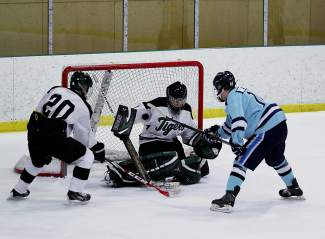 Summit's Wyatt Dickerson blocks a shot during the Tiger's 4-2 loss to defending state champ Ralston High School in January 2015. The Tigers boy's hockey team is winless this season, with a draw in early January against the Standley Lake Gators.