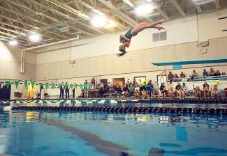 Summit dive team member Abby Hiller competes in the dive portion of a dual swim meet vs. Conifer at home on Jan. 12. Hiller won with a score of 162.45 in the finals and leads a seasoned group of Summit divers.