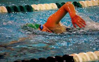 Summit's Maddy O'Malley swims during a meet on campus Jan. 12, 2016.