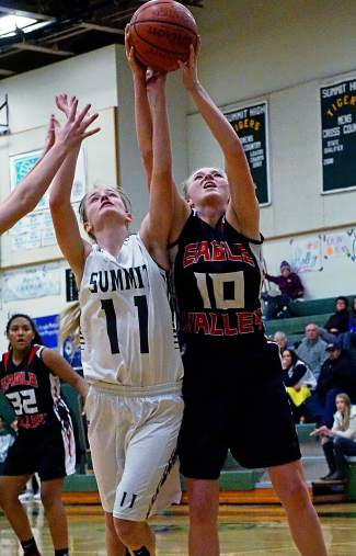 Summit's Megan McDonnell (11) goes after a rebound against Eagle Valley at home earlier this season. The senior captain set the Summit High School single-game scoring record on Jan. 26, putting up 27 points in the Tigers' 67-36 win over Glenwood Springs.