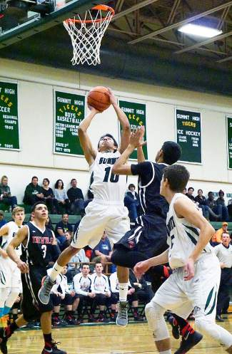 Summit's Jesus Moya (10) takes a shot during the Tigers' home win against Eagle Valley in mid-January.