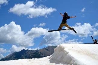A skier throws a spread eagle in the summer heat at Woodward's on-snow terrain park.