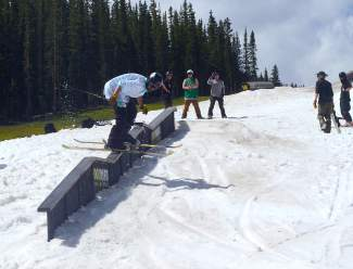 The author slides through the double-kink rail during an on-snow session at Woodward Copper in mid-July.