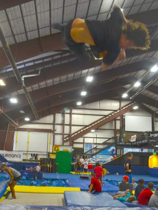 A Woodward coach gives a lesson in style on the indoor trampolines at The Barn, Woodward's main training facility found just outside of Center Village in Copper.