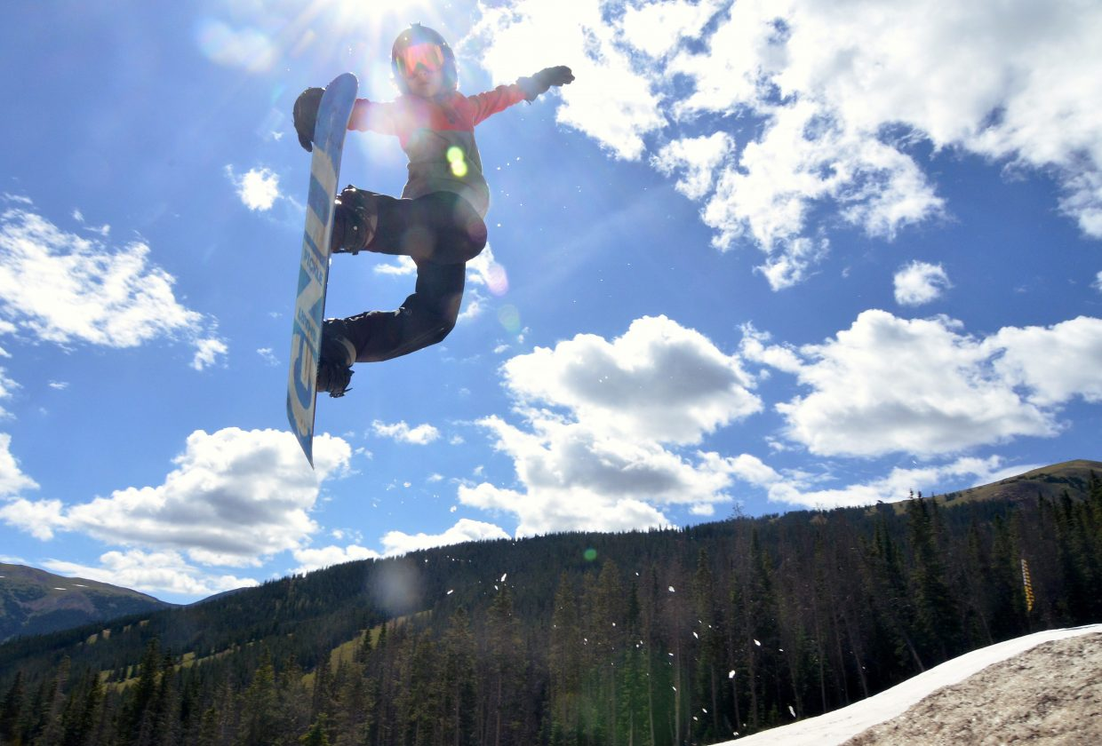 A Woodward Copper camper works on his method technique in the three-pack jump line at the summer snow park in July.