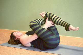 Yoga relief for hiking: reclined figure four pose.