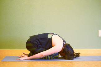 Yoga relief for hiking: child's pose.